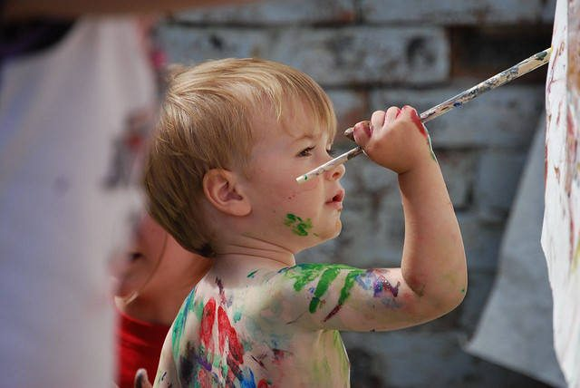boy painting outside